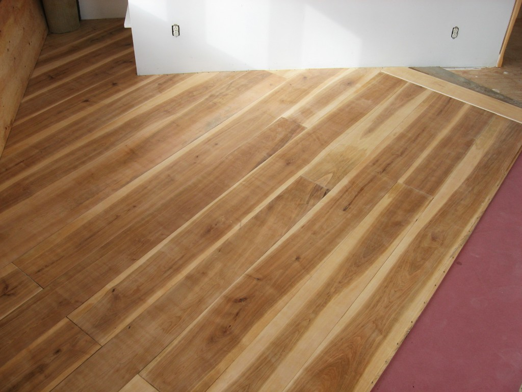 A wide plank floor from cutting trees to installation for Installing 3 4 inch hardwood flooring