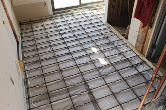 Radiant floor heat installation using thin slab pex run with re-bar method.