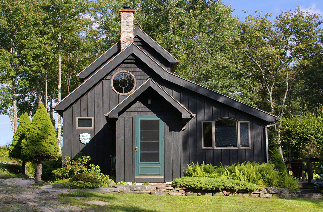 """Guest House summer 2014 with a new coat of Behr, """"Slate"""" solid color wood stain in late afternoon sun."""