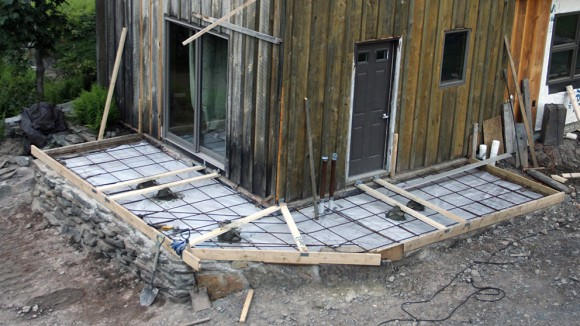 Porch deck slab ready for cement pour. Divided into 3 sections for easy screed.
