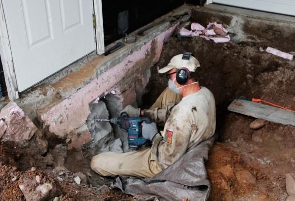 "John cutting a 18""x18"" hole through the 12"" thick basement wall."