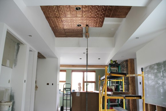 Snap Lock tin ceiling tiles being installed solo with the help of my grip stand rig.