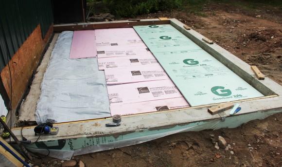 "Three layers; Insul-Tarp, 1"" ridged foam insulation and then 2"" foam insulation."