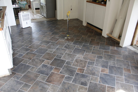 Wide view of the kithchen tiles. The center island was removed for this. The tiles took 5 days to lay and two days to grout. Well worth the effort to go diagonal, pine-wheel layout.