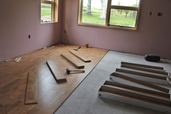 May- Click-lock, cork flooring was used to cover the bedroom radiant heat cement slab. https://www.homedepot.com/p/Heritage-Mill-Cobblestone-Plank-13-32-in-Thick-x-5-1-2-in-Wide-x-36-in-Length-Cork-Flooring-10-92-sq-ft-case-PF9656/2047