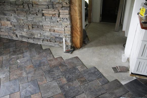 June- Kitchen tiles going down. What a tough job.